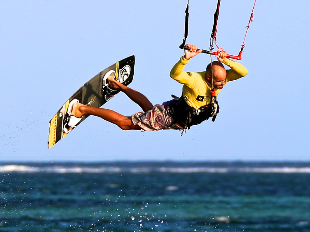 Image result for kitesurfer flying behind a kite